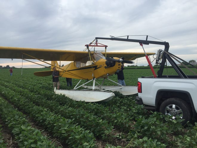 A 1945 Piper JC3-65 made an emergency landing in a soybean field in the town of Metomen Sunday, July 21, 2019 on its way from Lake Crystal, Minnesota to EAA AirVenture in Oshkosh.