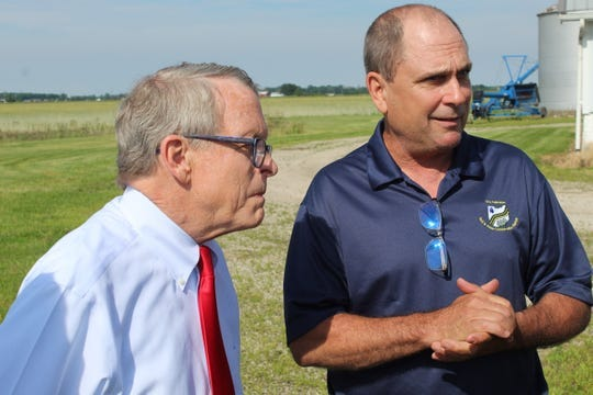 Governor Mike DeWine and Wood County farmer Kris Swartz speak in June about the disastrous impact of heavy rains this year on farmers. Swartz said most farmers are just looking to survive 2019 and hoping for a better growing season in 2020.