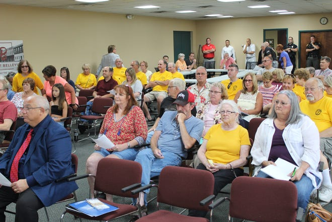 About 60 people showed up to Thursday's Sandusky County Commission meeting in Bellevue. Many were there to show their opposition to proposed wind energy projects in Sandusky, Seneca and surrounding counties.