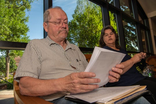 Lee and Kaye Collins look over paperwork before they appeal their home's evaluation to the Larimer County Board of Equalization on Friday, July 26, 2019, at the Larimer County office building.