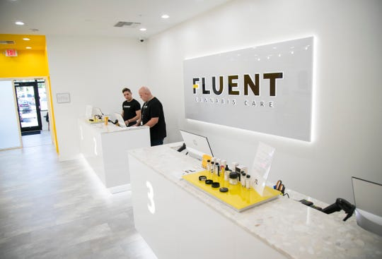 Fluent Cannabis Care employees get ready to open the shop on Wednesday morning, July 24, 2019, in south Fort Myers. The shop is in the same plaza with Chronic Tacos/Marlins Brewhouse.