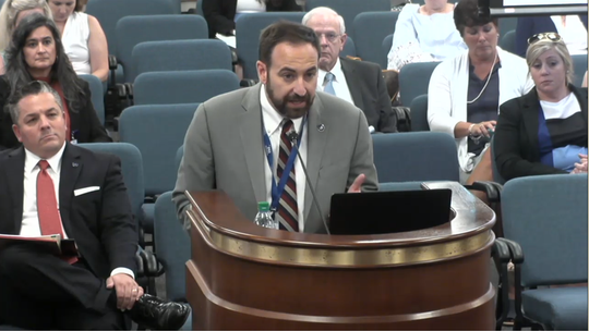 Michael Leach, South Carolina's new director of the embattled Department of Social Services agency, appeared for the first time before a state Senate oversight panel Thursday, July 25, 2019.