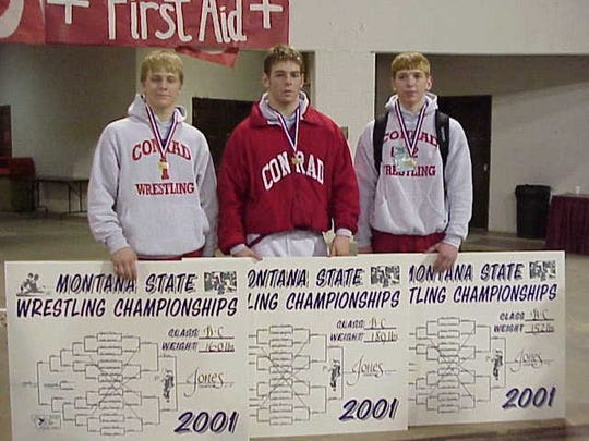 The three Jones brothers won state championships in 2001. Pictured are, from left, 160-pounder Daniel, who finished the season with a 34-6 record, senior 189-pounder Eddie, who finished 38-0, and sophomore 152-pounder Aaron, who finished 39-4. The three brothers combined for eight pins in 12 total matches at the state meet.