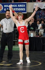 Conrad's Luke Schlosser celebrates after defeating Townsend's Logan Schwope in their 119-pound match for his fourth State B-C wrestling title on Feb. 11, 2012, in Billings.