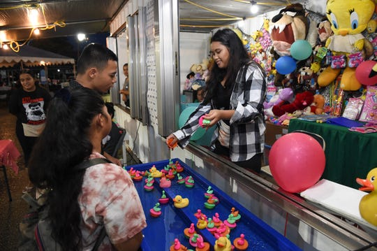 Carnival goers play a duck game at the Liberation carnival in Hagåtña on July 26, 2019.