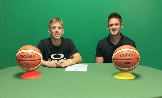 Jerod Boles, left, with UOG men's basketball coach Brent Tipton after Boles signed  a UOG Athletic Letter of Intent.