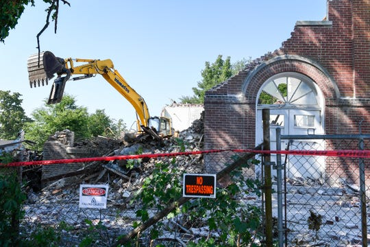 Making way for a $8.2 M Aududon Senior Apartments Project, workers with M. Bowling Inc., demolish the old Audubon School in Henderson's East End at the corner of Clay and Letcher streets Friday, July 26, 2019.