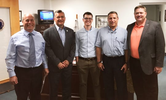 Henderson father Jordan Pyles (center) poses in legislative offices in Frankfort in 2017 with (from left) state Rep. Jason Petrie, the primary sponsor of the state's shared parenting bill; state Rep. (now Senator) Robby Mills of Henderson, a co-sponsor of the bill; Greg Wood, a fellow supporter of shared parenting for children of divorced or separated parents; and Matt Hale, founder and then-head of the Kentucky chapter of the National Parents Organization.