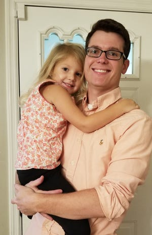 Jordan Pyles of Henderson holds his five-year-old daughter, Brileigh Locke-Pyles. He said Kentucky's 2018 shared parenting legislation helped ensure he has a regular role in her life. (Photo furnished)