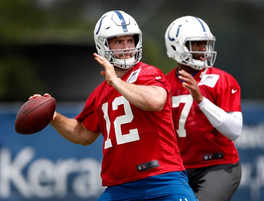 Indianapolis Colts quarterback Andrew Luck (12) and Jacoby Brissett (7) during their preseason training camp practice at Grand Park in Westfield on Friday, July 26, 2019.
