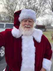 Ricky Parker of Camby in the new Santa suit that has gone missing since a Plainfield dry cleaner went out of business