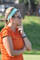 Victoria Weinhandl is in deep thought as she watches the Powell High girls soccer team in a scrimmage against Catholic High on Thursday, July 25. Weinhandl is the new coach at Powell.