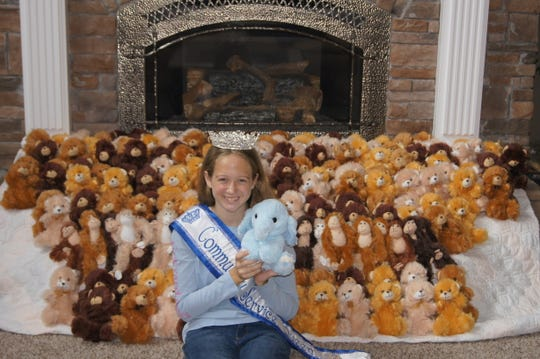 Lexi Hensley with about 288 of the 488 teddy bears she collected for the Tennessee Highway Patrol Hug a Buddy program Friday, July 19, 2019.