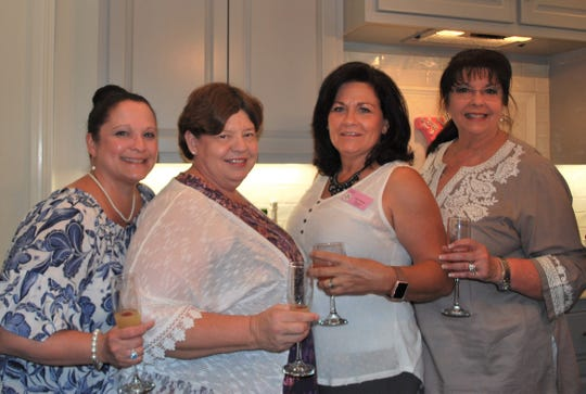Wendy Carroll, Hope Knijn, Lisa Vidrine and Sandra Booher raises their glasses and cheered at Xanadu's 30 year celebration