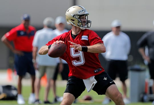 New Orleans Saints quarterback Drew Brees (9) runs through drills during training camp at their NFL football training facility in Metairie Friday. Brees said he was not worried about the long-term prospects of teammate Michael Thomas sitting out until he can reach a new deal with the team.
