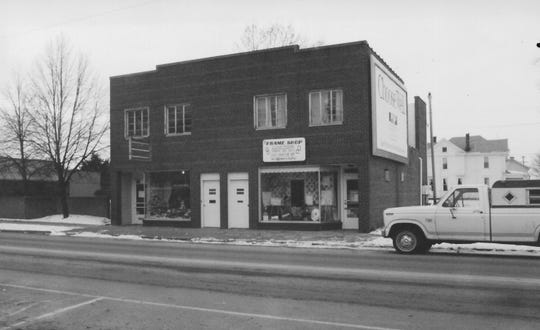 The 333/335 N. Columbus St. building is shown in this 1993 photo when only an empty lot was to the north of the building. The Frame Shop is located on the corner today.