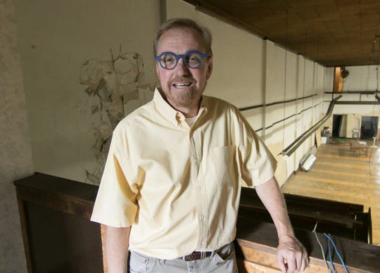 Jeff Doyle, on the balcony of what was once the office area of a former auto parts store Friday, July 26, 2019, has plans to redevelop The Pearl building in downtown Howell.