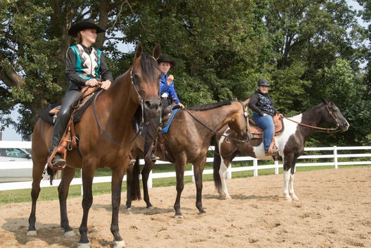 From left, Rebecca Bassett, Kylie Arbenowske and Paige Bonam compete in the 4-H equitation senior division Thursday, July 25, 2019 at the Fowlerville Family Fair. Michigan State University Extension cancelled all in-person 4-H events until September, but fair organizers have a plan B.