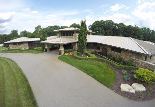 A home on Houghton Drive in Hamburg Township, shown Tuesday, July 23, 2019, is on the market for $1.35 million.
