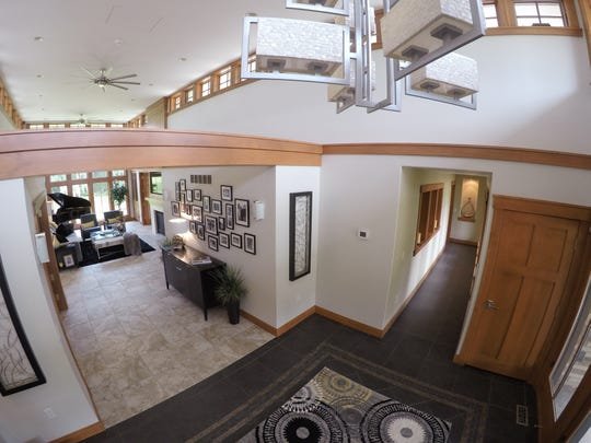 Beams across the open entryway leading into the living room of the Lewan home, shown Tuesday, July 23, 2019, provide an architectural accent.