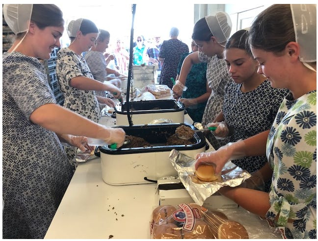 Volunteers Friday serve up roast beef sandwiches at the Shiloh Ox Roast. The festival continues Saturday.