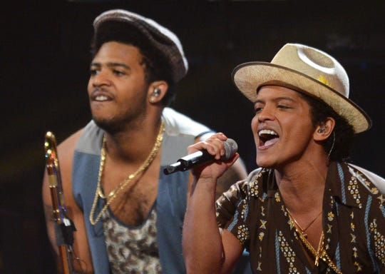 With Memphian Kameron Whalum on trombone, Bruno Mars performs at the iHeartRadio Music Festival on Sept. 21, 2013, in Las Vegas.
