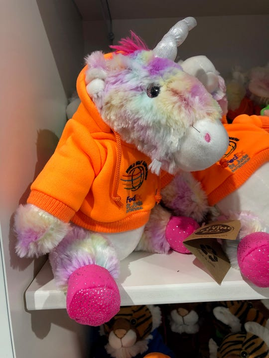 A stuffed unicorn at the WGC-FedEx St. Jude Invitational merchandise tent.