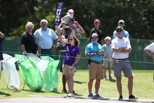 Kimberly Wilson holds a Hush Y'all sign as a volunteer on hole no. 11 at the St. Jude Invitational at TPC Southwind on Thursday, July 25, 2019. Wilson has volunteered at the course annually since 2017 when her husband passed away, after he volunteered for years on the same course.