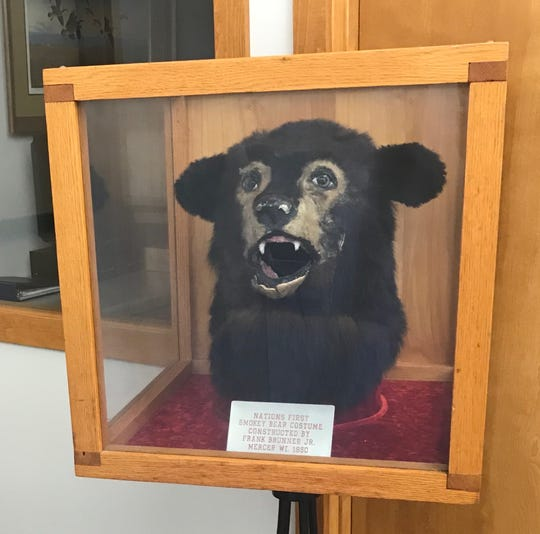 The head from the country's first Smokey Bear costume, created in 1950 by Mercer's Frank Brunner Jr., is on display in the Mercer Public Library.