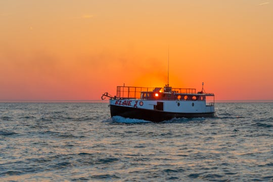 The Elsie J plies the waters of Lake Michigan during a sunset cruise.