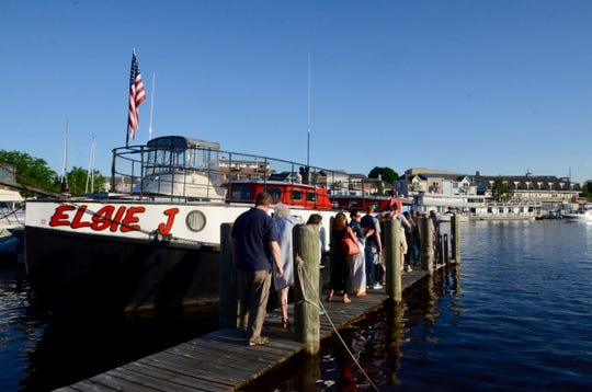 Passengers board the Elsie J, a 1945 fishing tug that now operates as a tour boat out of South Haven, Michigan.