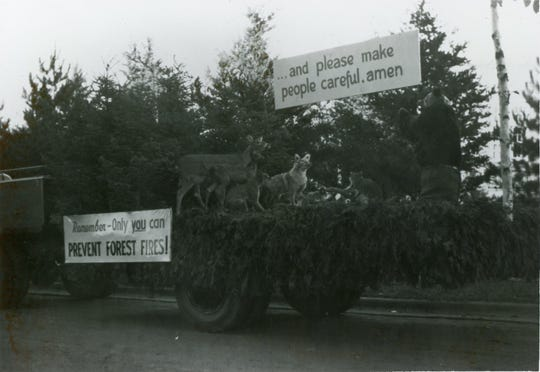 "A praying Smokey Bear statue appeared in the 1950 Fireman's Convention Parade in Hurley, Wisconsin, with other wildlife statues to mimic a 1948 Smokey Bear campaign poster that said ""... and please make people careful, amen."" The side of the float had Smokey's signature slogan, ""Remember — only you can prevent forest fires!"""