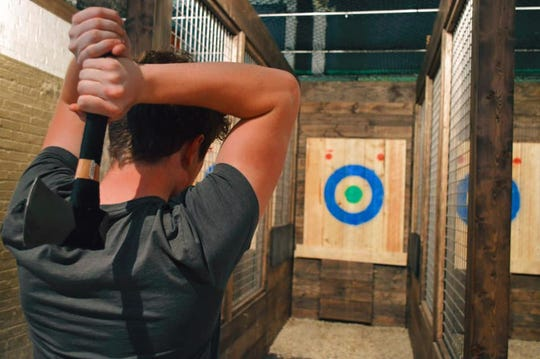 NorthSouth Club has 16 ax-throwing lanes and seven shuffleboard courts in its spot at 230 E Pittsburgh Ave.