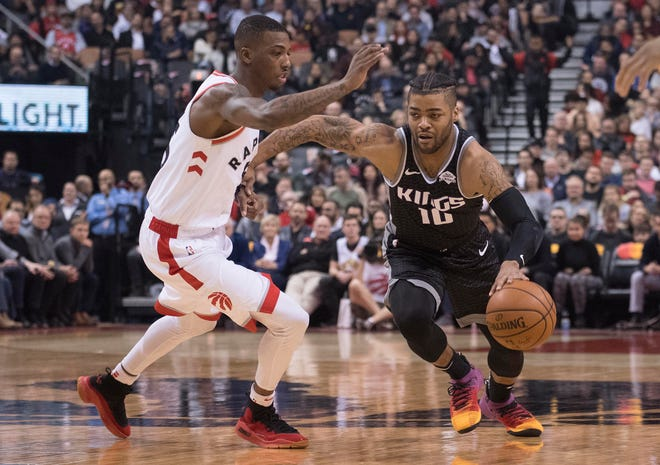 The Bucks signed former Kansas standout Frank Mason III (right) to a two-way contract on Friday. Mason spent the past two seasons with the Sacramento Kings and their G League affiliate.