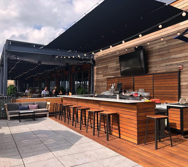 The Outsider on the rooftop at the Kimpton Journeyman Hotel in Milwaukee's Third Ward has added a new bar.