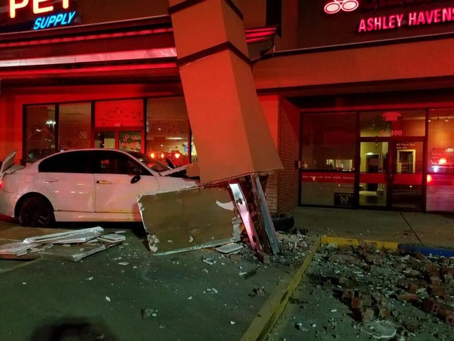 Three juveniles were reportedly uninjured after crashing a car into a support column and fleeing the scene early Friday morning.