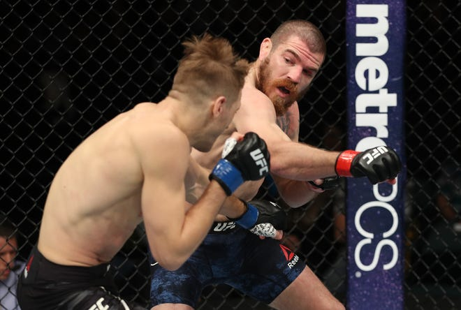 ATLANTIC CITY, NJ - APRIL 21:  (R-L) Jim Miller punches Dan Hooker of New Zealand in their lightweight fight during the UFC Fight Night event at the Boardwalk Hall on April 21, 2018 in Atlantic City, New Jersey. (Photo by Patrick Smith/Zuffa LLC/Zuffa LLC via Getty Images)