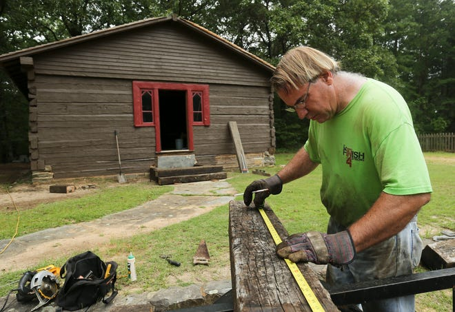 Sam Wilson works to restore the old church located on New Watermelon Road July 19, 2019 in Tuscaloosa, Alabama. The church has been part of his family since the 1860s.