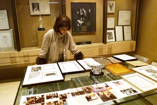 Linda Johnson Rice, president and chief operating officer of Jet magazine, looks over awards and recognitions won by the magazine in its 50-year lifetime at Jet's Chicago headquarters in this file photo.