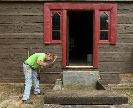 Sam Wilson works to restore the old church located on New Watermelon Road July 19, 2019 in Tuscaloosa, Ala. The church has been part of his family since the 1860s.