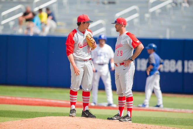 Dustin Glant (right) speaks with a Ball State pitcher during a game. Glant spent the past three seasons as the Cardinals' pitching coach before taking a job in the New York Yankees' organization.
