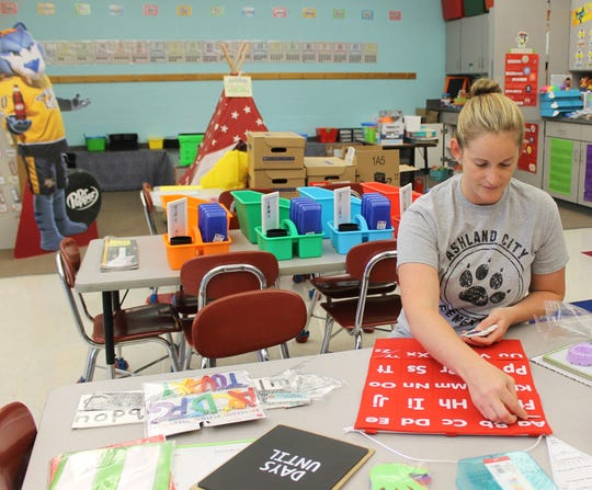 Ashland City Elementary School kindergarten teacher Nicole Klingmann prepares her classroom for the new school year.