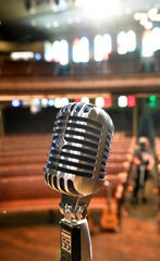 A microphone sits on stage at the legendary Ryman Auditorium.