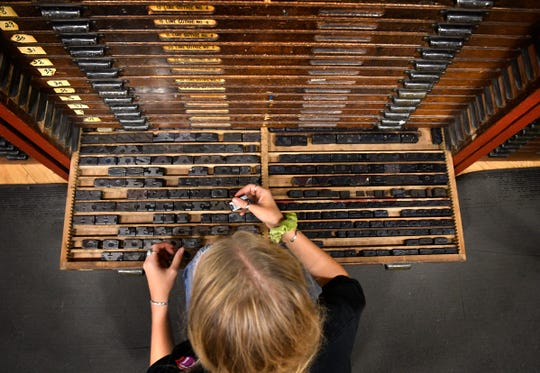 Letterpress printmakers search through thousands of metal letters to make the perfect poster July 23, 2019, at Hatch Show Print, located inside the Country Music Hall of Fame and Museum in Nashville.