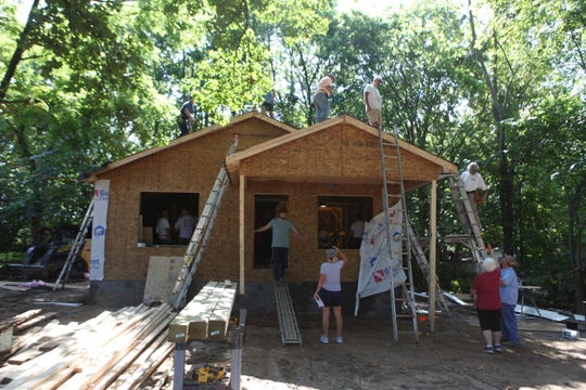 Volunteers from Grace Baptist Church in Springfield and Grace Baptist Church in Nashville worked together to build a house for a homeless family they've never met.