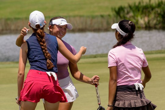 From left to right, Gabriella Vetter, Kim Egozi, and Nicole Yugay cheer with each other on Friday, July 26, 2019, during the 27th Patty Berg Junior Championship at Wyndemere Country Club in Naples.