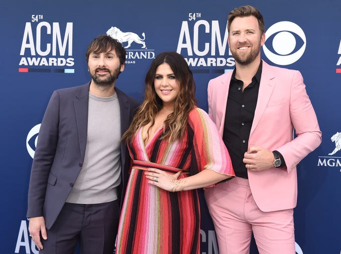 Dave Haywood, from left, Hillary Scott and Charles Kelley, of Lady Antebellum, arrive at the 54th annual Academy of Country Music Awards at the MGM Grand Garden Arena on Sunday, April 7, 2019, in Las Vegas.