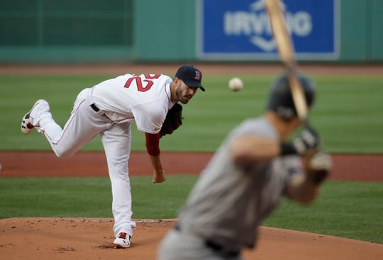 Boston Red Sox starting pitcher Rick Porcello delivers to New York Yankees' DJ LeMahieu in the first inning of a baseball game at Fenway Park, Thursday, July 25, 2019, in Boston.