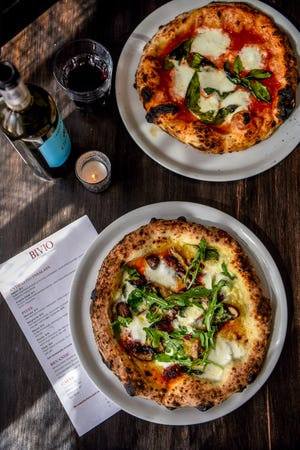Bivio Pizza Napoletana in Montclair   on Thursday July 25, 2019. (From top) Margherita pizza and Nduja pizza with spicy calabrese sausage, a mix of wild mushrooms and buffalo mozzarella