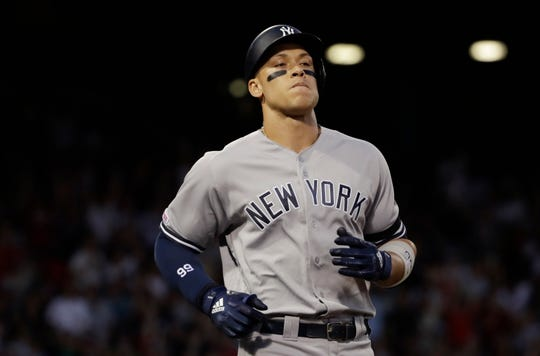 New York Yankees' Aaron Judge reacts after flying out to end the second inning against the Boston Red Sox in a baseball game at Fenway Park, Thursday, July 25, 2019, in Boston. (AP Photo/Elise Amendola)